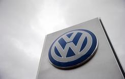 A VW sign is seen outside a Volkswagen dealership in London, Britain November 5, 2015. REUTERS/Suzanne Plunkett