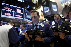 Traders work on the floor of the New York Stock Exchange in New York, December 16, 2015. REUTERS/Brendan McDermid