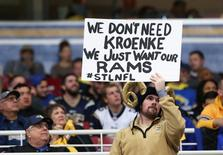 Dec 17, 2015; St. Louis, MO, USA; A St. Louis Rams fan holds a sign in the second half against the Tampa Bay Buccaneers at the Edward Jones Dome. The Rams won 31-23. Mandatory Credit: Aaron Doster-USA TODAY Sports