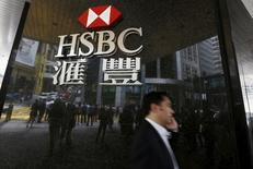 A man walks past a logo of HSBC outside a branch at the financial Central district in Hong Kong, China June 2, 2015.   REUTERS/Bobby Yip