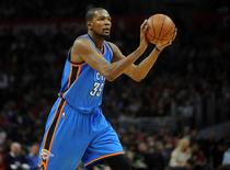 December 21, 2015; Los Angeles, CA, USA; Oklahoma City Thunder forward Kevin Durant (35) attempts a shot  against Los Angeles Clippers during the first half  at Staples Center. Mandatory Credit: Gary A. Vasquez-USA TODAY Sports