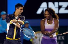 Novak Djokovic of Serbia and Serena Williams of the U.S. dance Gangnam Style during the Kids Tennis Day at the Australian Open tennis tournament in Melbourne January 12, 2013.  REUTERS/Damir Sagolj/Files