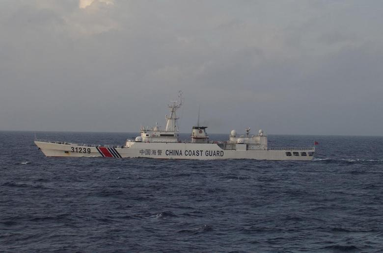 China Coast Guard vessel No. 31239 sails in the East China Sea near the disputed isles known as Senkaku isles in Japan and Diaoyu islands in China, in this handout photo taken and released by the 11th Regional Coast Guard Headquarters-Japan Coast Guard December 22, 2015.  Mandatory Credit REUTERS/11th Regional Coast Guard Headquarters-Japan Coast Guard/Handout via Reuters