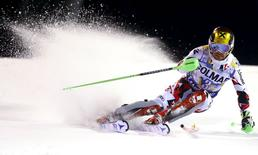 Marcel Hirscher of Austria clears a gate during the first run in the men's slalom at the Alpine Skiing World Cup in Madonna di Campiglio, northern Italy, December 22, 2015. REUTERS/Dominic Ebenbichler -
