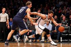 Dec 23, 2015; Brooklyn, NY, USA; Brooklyn Nets center Brook Lopez (11) grabs a rebound in front of Dallas Mavericks power forward Dirk Nowitzki (41) during the fourth quarter at Barclays Center. The Mavericks defeated the Nets 119-118 in overtime. Mandatory Credit: Brad Penner-USA TODAY Sports