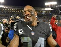 Dec 24, 2015; Oakland, CA, USA; Oakland Raiders free safety Charles Woodson (24) reacts after playing his final home game during an NFL football game against the San Diego Chargers at O.co Coliseum. The Raiders defeated the Chargers 23-20 in overtime. Kirby Lee-USA TODAY Sports
