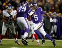 Dec 27, 2015; Minneapolis, MN, USA; Minnesota Vikings quarterback Teddy Bridgewater (5) rushes against the New York Giants in the third quarter at TCF Bank Stadium. The Vikings win 49-17. Mandatory Credit: Bruce Kluckhohn-USA TODAY Sports