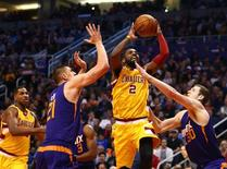 Dec 28, 2015; Phoenix, AZ, USA; Cleveland Cavaliers guard Kyrie Irving (2) drives to the basket against the Phoenix Suns at Talking Stick Resort Arena. Mandatory Credit: Mark J. Rebilas-USA TODAY Sports