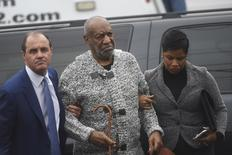 Actor and comedian Bill Cosby arrives with attorney Monique Pressley (R) for his arraignment on sexual assault charges at the Montgomery County Courthouse in Elkins Park, Pennsylvania December 30, 2015.  REUTERS/Mark Makela