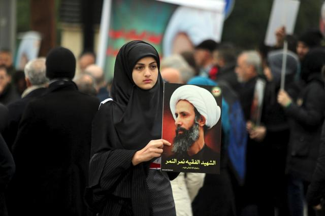A girl carries a picture of Sheikh Nimr al-Nimr, who was executed along with others in Saudi Arabia, during a protest against the execution in front of the United Nation's building in Beirut, Lebanon January 3, 2016.  Sign reads, ''The martyr scholar Nimr al-Nimr''. REUTERS/Hasan Shaaban