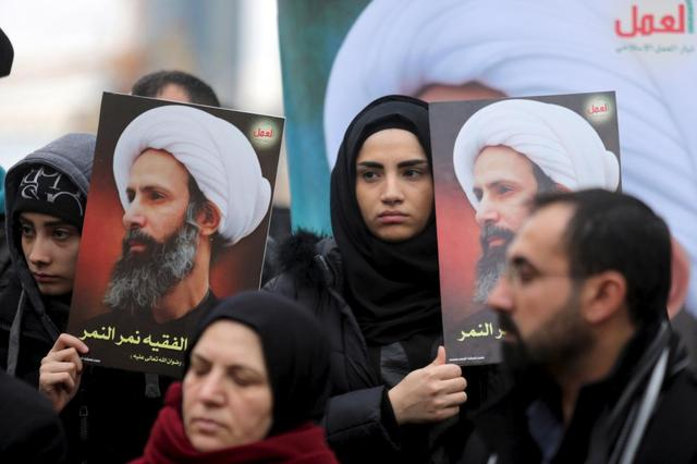 Protesters carry pictures of Sheikh Nimr al-Nimr, who was executed along with others in Saudi Arabia, during a protest against his execution in front of the United Nations building in Beirut, Lebanon January 3, 2016. REUTERS/Hasan Shaaban