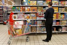 A man looks at children's toys at a supermarket on the outskirts of Budapest, Hungary, December 8, 2015. Picture taken December 8, 2015. REUTERS/Bernadett Szabo