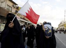 Protesters holding posters of Saudi Shi'ite cleric Nimr al-Nimr and a Bahraini national flag protest against his execution by Saudi authorities in the village of Sanabis, west of Manama, Bahrain January 3, 2016. REUTERS/Hamad I Mohammed