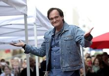 Filmmaker Quentin Tarantino acknowledges fans before the unveiling of his star on the Hollywood Walk of Fame in Hollywood, California, December 21, 2015. REUTERS/Kevork Djansezian