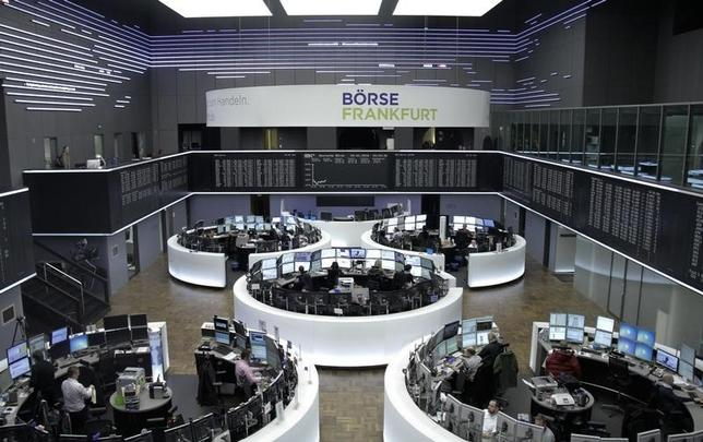 Traders are pictured at their desks in front of the DAX board at the stock exchange in Frankfurt, Germany January 4, 2016. REUTERS/Staff/remote
