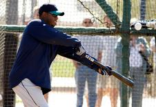 Ken Griffey Jr. bunts the ball during spring training camp in 2010.    REUTERS/Rick Scuteri