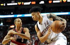 Dec 20, 2015; Miami, FL, USA; Miami Heat guard Gerald Green (14) dribbles the ball as Portland Trailblazer guard C.J. McCollum (3) defends at American Airlines Arena. Mandatory Credit: Robert Duyos-USA TODAY Sports
