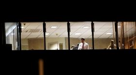 People work in the offices of CONMEBOL in Luque, Paraguay, January 7, 2016. REUTERS/Jorge Adorno