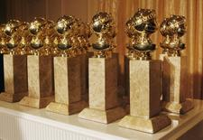 The Hollywood Foreign Press Association's new Golden Globe statuettes are shown during a news conference in Beverly Hills, California in this file photo taken on January 6, 2009. REUTERS/Fred Prouser/Files