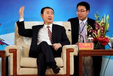 Wang Jianlin, chairman of Dalian Wanda Group, gestures as he speaks ahead of a signing ceremony with Spanish soccer champions Atletico Madrid in Beijing, January 21, 2015. REUTERS/Jason Lee