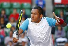 Nick Kyrgios of Australia returns the ball to Roberto Bautista Agut of Spain during their men's singles tennis match at the Japan Open championships in Tokyo October 8, 2015.   REUTERS/Thomas Peter