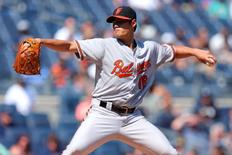 Baltimore Orioles starting pitcher Wei-Yin Chen (16) pitches against the New York Yankees during the second inning at Yankee Stadium. Brad Penner-USA TODAY Sports