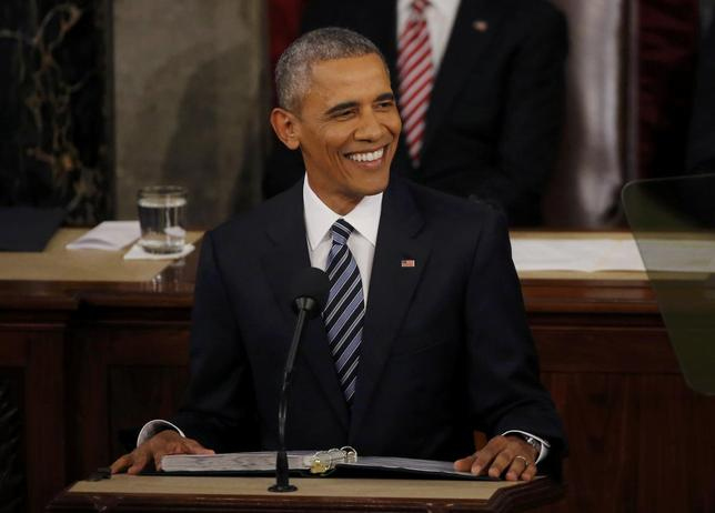 U.S. President Barack Obama smiles as he delivers his State of the Union address to a joint session of Congress in Washington, January 12, 2016. REUTERS/Carlos Barria