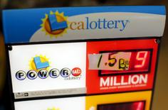 A handwritten sign is seen taped over electronic numbers on a Powerball sign at a corner store in San Diego, California January 13, 2016. REUTERS/Mike Blake