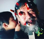 Dissident Chinese artist Ai Weiwei is seen with Lego bricks on his face in this undated image taken from his Instagram account and provided by Ai Weiwei Studio January 14, 2016.   REUTERS/Ai Weiwei Studio/Handout