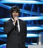 Co-founder of Foursquare Dennis Crowley presents an award during the 15th annual Webby Awards in New York June 13, 2011. REUTERS/Lucas Jackson