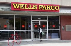 A customer enters the Wells Fargo bank branch in Golden, Colorado October 11, 2013. REUTERS/Rick Wilking