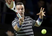 Roberto Bautista Agut of Spain hits a return against Marin Cilic of Croatia during their Kremlin Cup men's single tennis match final in Moscow, Russia, October 25, 2015. REUTERS/Maxim Shemetov