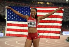 Aug 27, 2015; Beijing, China; Allyson Felix (USA) poses with the United States flag after winning the womens 400m in 49.26 during the IAAF World Championships in Athletics at National Stadium. Mandatory Credit: Kirby Lee-USA TODAY Sports
