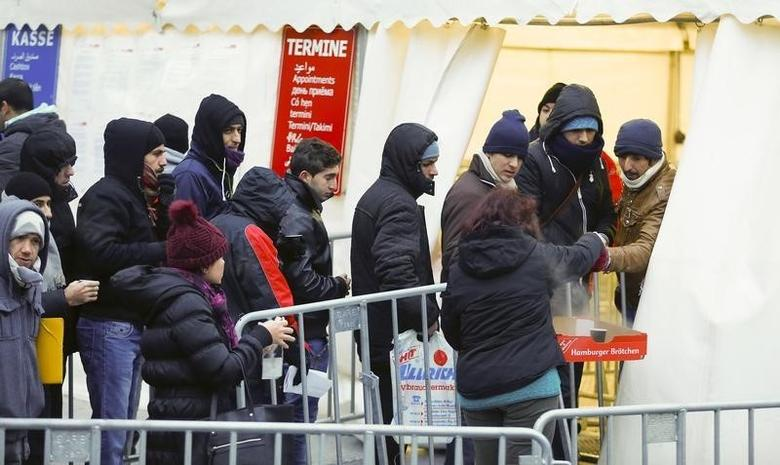 Migrants queue to enter a tent that serves as a waiting room at the the Berlin Office of Health and Social Affairs (LAGESO), in Berlin, Germany, January 5, 2016. REUTERS/Hannibal Hanschke