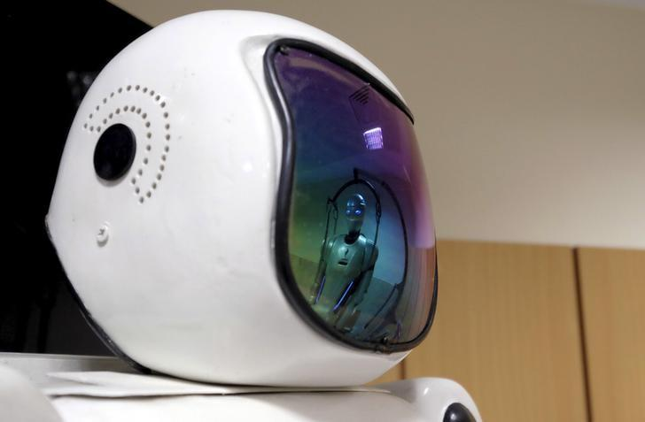 REPRESENTATIVE IMAGE: Surena 3 humanoid robot is reflected in the glass of Surena 2 robot, in a lab at Tehran University, Iran December 6, 2015.  REUTERS/Raheb Homavandi/TIMA/Files