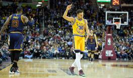 Jan 18, 2016; Cleveland, OH, USA; Golden State Warriors guard Stephen Curry (30) reacts beside Cleveland Cavaliers forward LeBron James (23) in the third quarter at Quicken Loans Arena. Mandatory Credit: David Richard-USA TODAY Sports