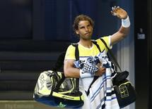 Spain's Rafael Nadal waves to the crowd as he leaves after losing his first round match against Spain's Fernando Verdasco at the Australian Open tennis tournament at Melbourne Park, Australia, January 19, 2016. REUTERS/Thomas Peter