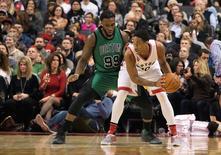 Jan 20, 2016; Toronto, Ontario, CAN; Toronto Raptors guard DeMar DeRozan (10) handles the ball as Boston Celtics forward Jae Crowder (99) tries to defend  during the fourth quarter in a game at Air Canada Centre. The Toronto Raptors won 115-109.  Nick Turchiaro-USA TODAY Sports