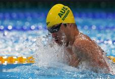 Australia's Christian Sprenger swims in the men's 50m breaststroke semi-final during the World Swimming Championships at the Sant Jordi arena in Barcelona July 30, 2013. REUTERS/Albert Gea/Files