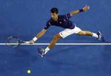 Serbia's Novak Djokovic stretches to hit a shot during his second round match against France's Quentin Halys at the Australian Open tennis tournament at Melbourne Park, Australia, January 20, 2016. REUTERS/Jason O'Brien