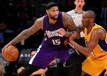 Jan 20, 2016; Los Angeles, CA, USA;   Los Angeles Lakers forward Kobe Bryant (24) guards Sacramento Kings center DeMarcus Cousins (15) in the second half of the game at Staples Center. Kings won 112-93. Mandatory Credit: Jayne Kamin-Oncea-USA TODAY Sports