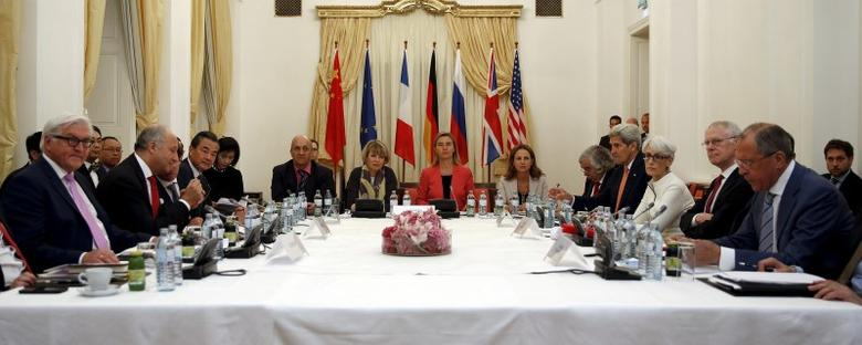German Foreign Minister Frank-Walter Steinmeier (L), French Foreign Minister Laurent Fabius (2nd L), Chinese Foreign Minister Wang Yi (3rd L), European Union foreign policy chief Federica Mogherini (Centre in red), U.S. Secretary of State John Kerry (4th R) and Russian Foreign Minister Sergei Lavrov (R) meet at a hotel in Vienna July 13, 2015.  REUTERS/Carlos Barria