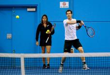 Britain's Andy Murray hits a shot as his coach Amelie Mauresmo watches during a practice session at the Australian Open tennis tournament at Melbourne Park, Australia, January 22, 2016. REUTERS/Jason O'Brien