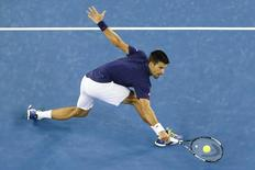 Serbia's Novak Djokovic stretches to hit a shot during his third round match against Italy's Andreas Seppi at the Australian Open tennis tournament at Melbourne Park, Australia, January 22, 2016. REUTERS/Jason O'Brien
