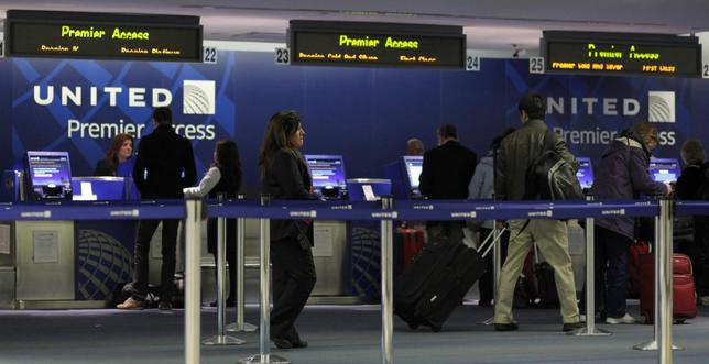 united international flight check in policy