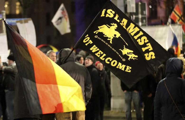 Members of LEGIDA, the Leipzig arm of the anti-Islam movement PEGIDA, take part in a rally in Leipzig, Germany January 11, 2016. REUTERS/Fabrizio Bensch