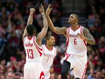 Jan 22, 2016; Houston, TX, USA; Houston Rockets guard James Harden (13) and forward Trevor Ariza (1) and forward Terrence Jones (6) celebrate during the second half against the Milwaukee Bucks at the Toyota Center. The Rockets defeat the Bucks 102-98. Mandatory Credit: Jerome Miron-USA TODAY Sports