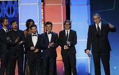 "Director Adam McKay (R) accepts the award for Best Comedy for ""The Big Short"" along with actor Christian Bale (2nd from L) and other cast and crew at the 21st Annual Critics' Choice Awards in Santa Monica, California January 17, 2016.  REUTERS/Mario Anzuoni"