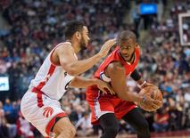Jan 24, 2016; Toronto, Ontario, CAN; Los Angeles Clippers guard Chris Paul (3) shields the ball from Toronto Raptors guard Cory Joseph (6) in the first quarter at Air Canada Centre. Mandatory Credit: Peter Llewellyn-USA TODAY Sports