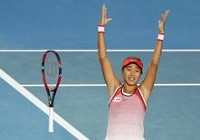China's Zhang Shuai celebrates after winning her fourth round match against Madison Keys of the U.S. at the Australian Open tennis tournament at Melbourne Park, Australia, January 25, 2016. REUTERS/Issei Kato